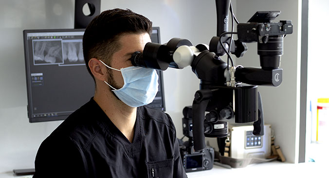Dr. Gilberto Galvez with Microscope
